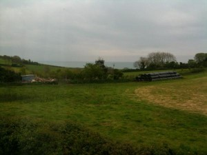 View of a field with sea in the background near Slapton Devon