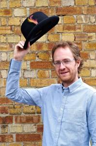 Tam waving bowler hat